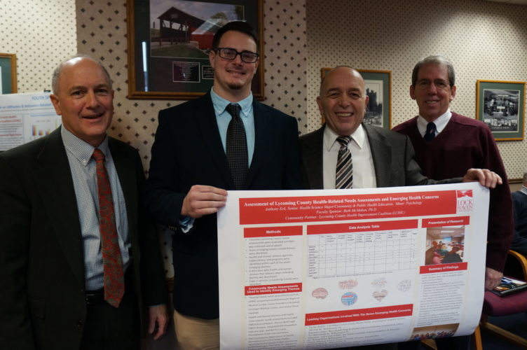 PHOTO PROVIDED Shown from left, are Rick Mirabito, Lycoming County commissioner; Anthony Eck, Lock Haven University senior; and commissioners Tony Mussare and Jack McKernan.