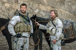 "This image released by Warner Bros. Entertainment shows Chris Hemsworth, left, and Thad Luckinbill in a scene from ""12 Strong."" (David James/Warner Bros. Entertainment via AP)"