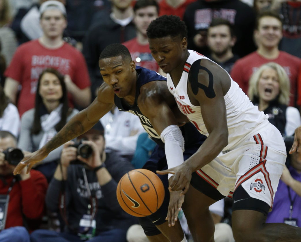 Penn State guard Tony Carr, reaches for the ball against Ohio State forward Jae'Sean Tate during the first half of an NCAA college basketball game in Columbus, Ohio, Thursday, Jan. 25, 2018. (AP Photo/Paul Vernon)