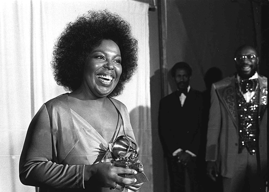 "FILE - In this March 4, 1974 file photo, Roberta Flack holds the Grammy award for record of the year for ""Killing Me Softly With His Song"" at the 16th annual Grammy Awards in Los Angeles. Flack, one of only two artists who have won the category two years in a row, won in 1973 for ÒThe First Time Ever I Saw Your Face."" (AP Photo, File)"