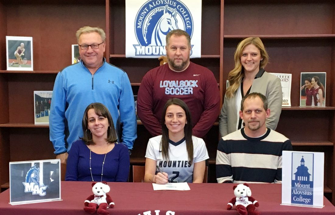 SUBMITTED PHOTO Loyalsock's Jenna Gardner will play soccer at Mount Aloysius College. Up front are Jenna and parents Valerie and Daniel. In back are Loyalsock athletic director Ron Insinger, coach Ben Comfort, and principal/assistant coach Ashley Sekel.