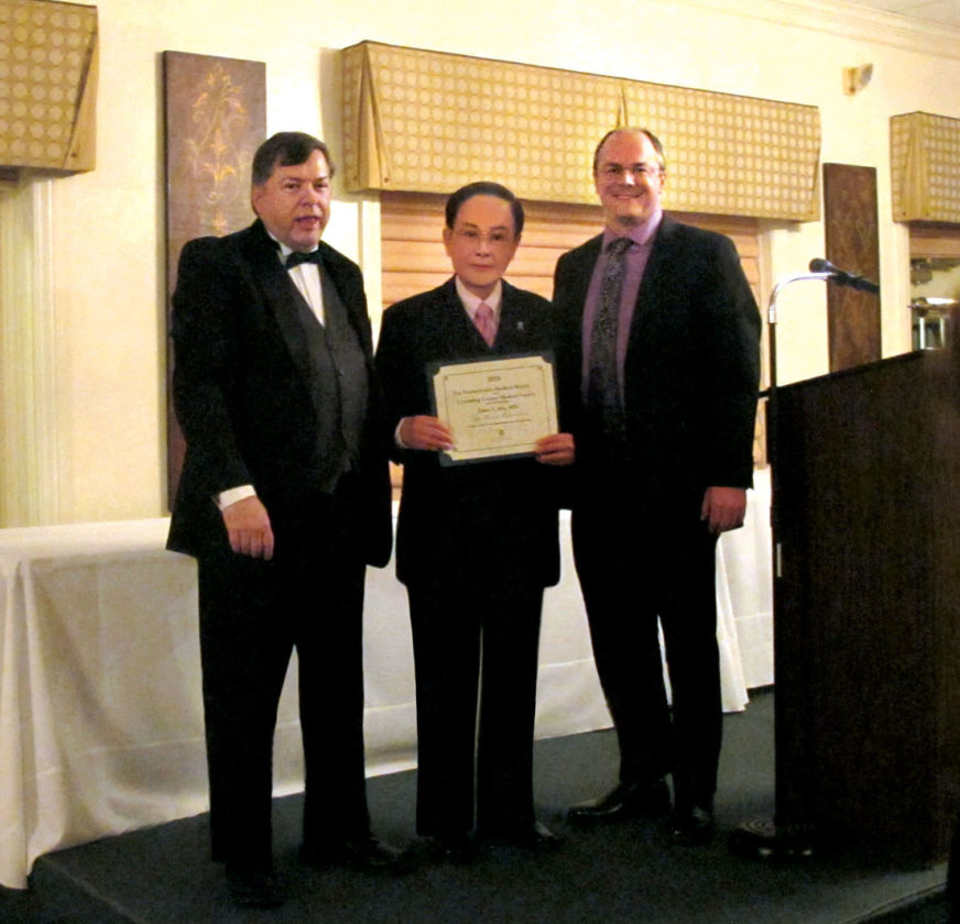 PHOTO PROVIDED Dr. Jason Shu, center, is honored by the Pennsylvania Medical Society and the Lycoming County Medical Society President Dr. Quinn Kirk right, and former President Dr. Tim Heilmann, left.