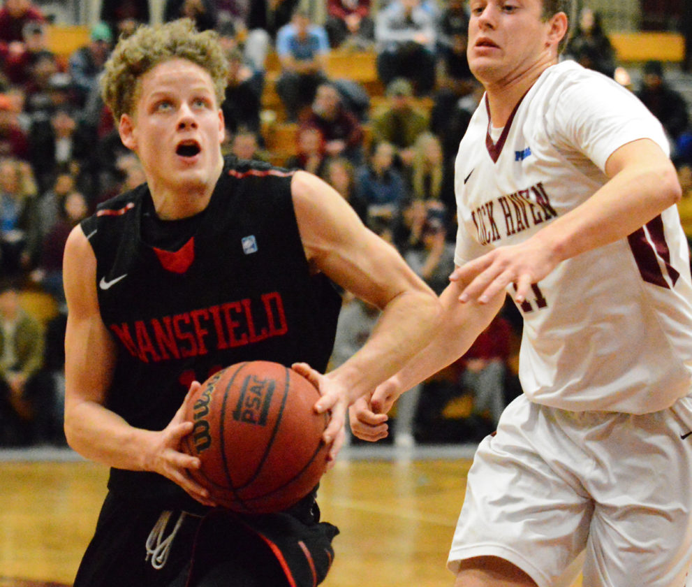 PHOTOPROVIDED/Mansfield Athletics Mansfield's Tyler Moffe drives for a basket against a Lock Haven defender on Wednesday.