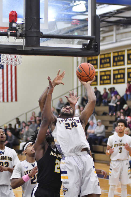 MARK NANCE/Sun-Gazette     Lycoming's Chris Wallace (24) shoots over Alvernia's Anthony Dadson in the first half.