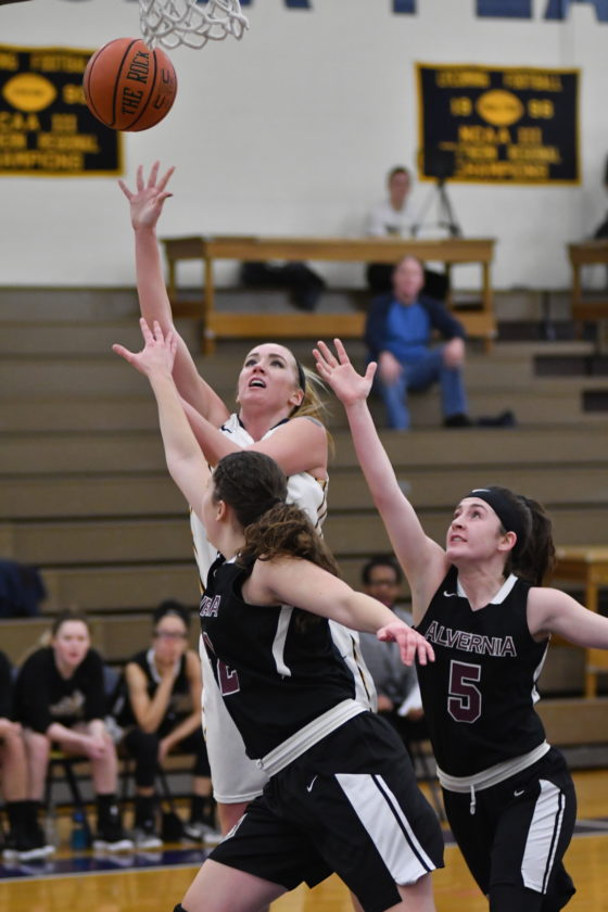 MARKNANCE/Sun-Gazette Lycoming's Shelby Mueller shoots over Alvernia's Liv Andrefski (22) and Kiersten Ingram (5) in the second quarter of the Warriors' women's basketball game on Wednesday evening at Lamade Gymnasium.