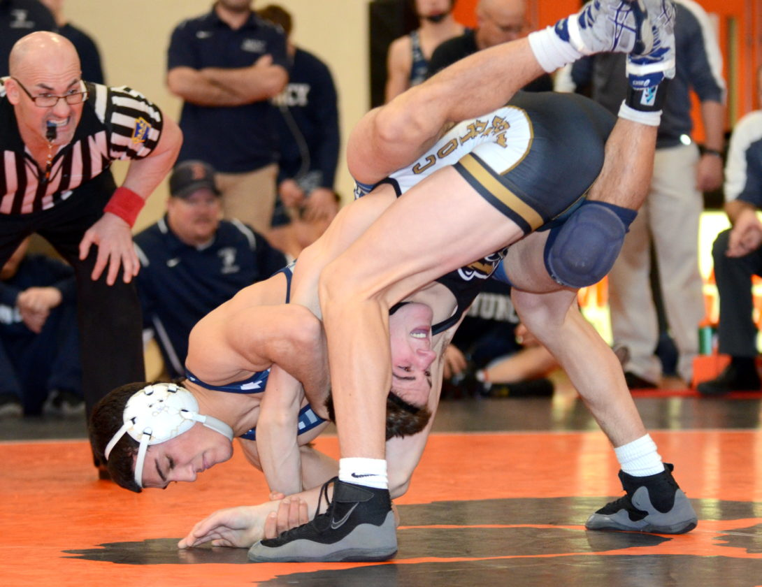 FRANK DIMON/For The Sun-Gazette Muncy's Coleman Good works to keep Southern Columbia's Tyler Waltman on the mat at 145 pounds during the championship final of the District 4 Duals Saturday night at Milton.