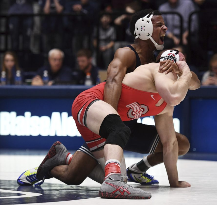 ASSOCIATED PRESS Penn State's Mark Hall, top, wrestles Ohio State's Bo Jordan at 174 pounds Saturday at Penn State's Rec Hall.