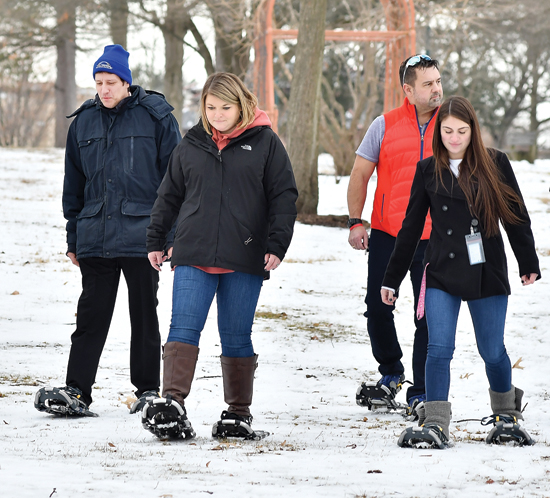 MARK NANCE/Sun-Gazette City and Brandon Park officials try out snow shoeing at Brandon Park Thursday afternoon. From left is Sue Stackhouse, volunteer at Crystal Lake, Mayor Gabriel Campana, Jessie Novinger, city recreation director, Thad Meckley, Brandon Park Commission chairman, and Jessica Franco, Lycoming College senior and intern for the city recreation department. There will be snow shoeing in the park on Friday Feb. 9 from 5-7 pm for those interested in trying out the sport.