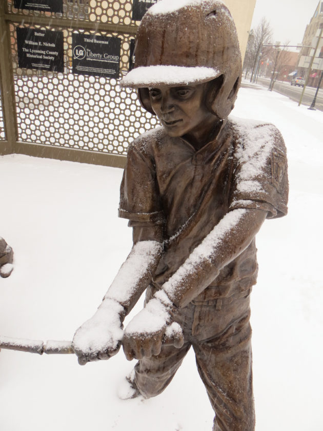 CARA MORNINGSTAR/Sun-Gazette The Bases Loaded statues at the intersection of Market Street and Third Street stand in the snow during Sunday's snow fall in Williamsport.
