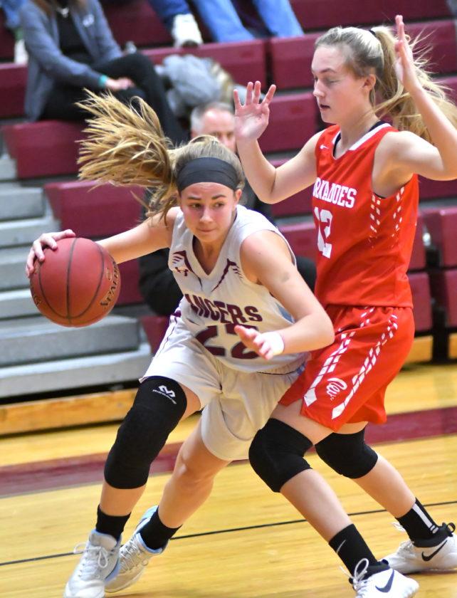 MARKNANCE/Sun-Gazette Loyalsock's Rhiallie Jessell (22) drives around Mount Carmel's Emilee Wasilewski in the third quarter on Tuesday at Loyalsock High School.