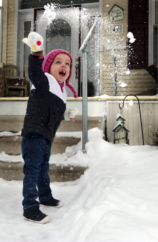 KAREN VIBERT-KENNEDY/Sun-Gazette Arabella Declerck, 3, of Hughesville has a ball throwing snow into the air as more white stuff falls from the sky on Wednesday.