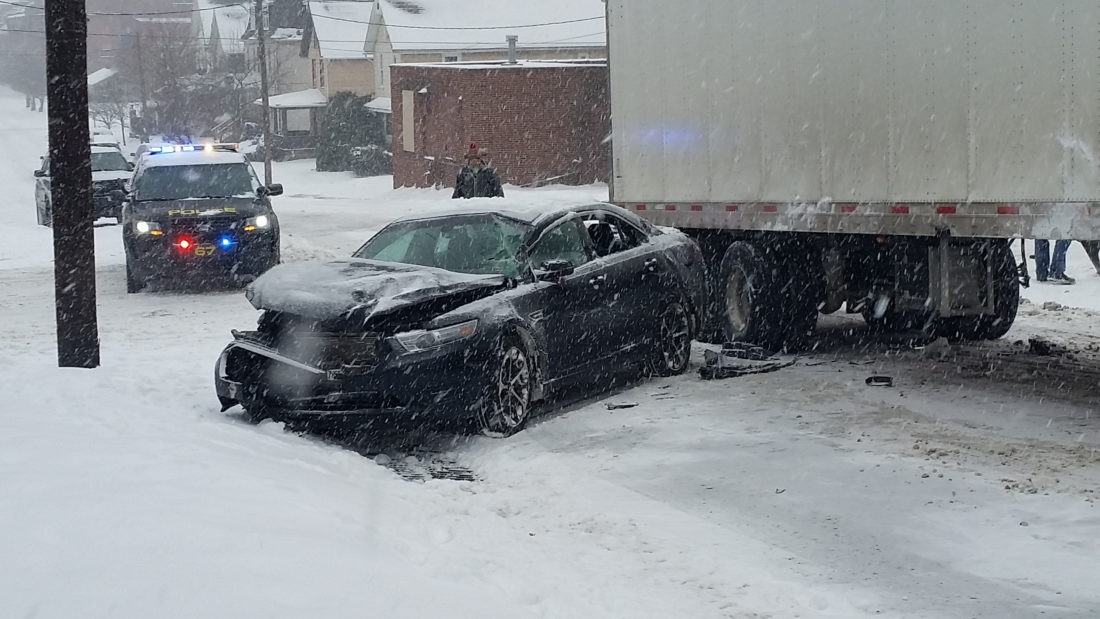 PHILIP A. HOLMES/Sun-Gazette  Slippery road conditions contributed to causing this two-vehicle crash at High and Rose streets about 9:20 a.m. Wednesday, city police said. The driver of the car declined treatment for minor injuries. There were very few crashes in the area during Wednesday's snowstorm that dumped about 3 inches in the city.