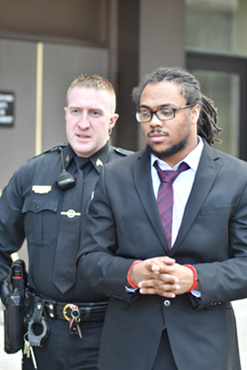 MARK NANCE/Sun-Gazette Brandon Love, 22, of the city, is escorted by the sheriff's deputies following day three of his homicide trial at the Lycoming County Courthouse Thursday.