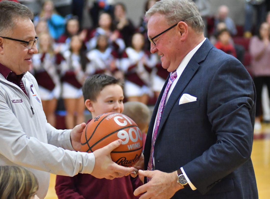 MARK NANCE/Sun-Gazette Loyalsock Superintendent Gerald McLaughlin presents a basketball to Boysl Basketball Head Coach Ron Insinger after his 900th career win Saturday.