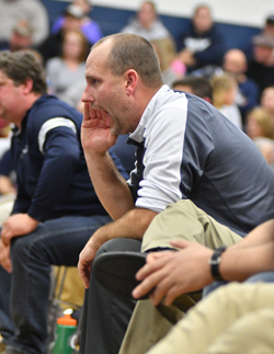 MARKNANCE/Sun-Gazette Muncy head coach Denny Harer gives his wrestler instruction during a match against Southern Columbia last month.