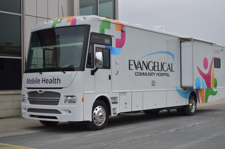 KATELYN HIBBARD/Sun-Gazette The mobile health bus sits in front of Evangelical Community Hospital.