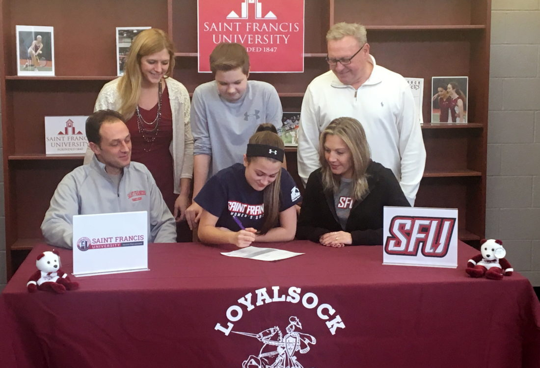 PHOTO PROVIDED Loyalsock's Ana Barone signed her letter of intent to play soccer at Saint Francis University. Sitting next to Ana are her parents, Matt (left) and Stacy Barone. Standing are Loyalsock assistant principal Ashley Sekel, brother Matt Barone and Loyalsock athletic director Ron Insinger.