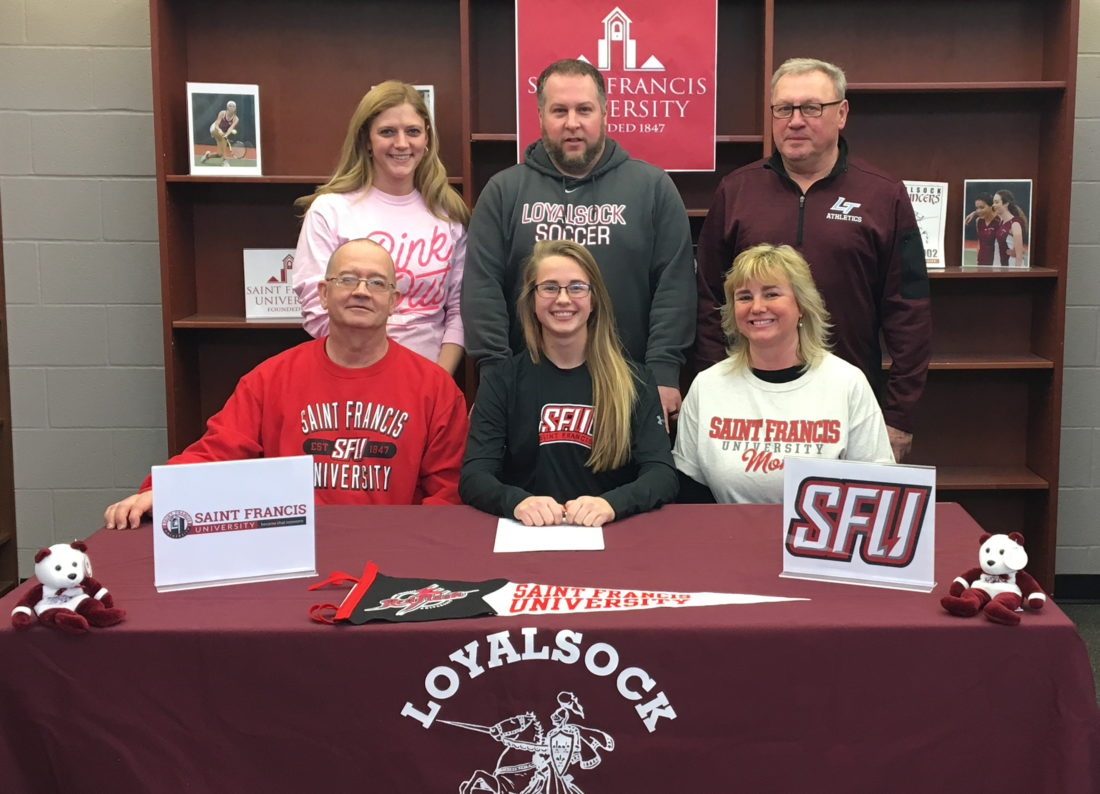 PHOTO PROVIDED Loyalsock's Rhialle Jessell signed her letter of intent to play soccer at Saint Francis University. Sitting next to Rhiallie are her parents, Randy (left) and Ginny Jessell. Standing are Loyalsock assistant principal Ashley Sekel, Loyalsock girls coach Ben Comfort and Loyalsock athletic director Ron Insinger.