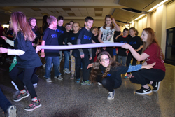 IOANNIS PASHAKIS/Sun-Gazette Central Elementary school student Olivia Miller plays limbo with her classmates during the two hour dance marathon.