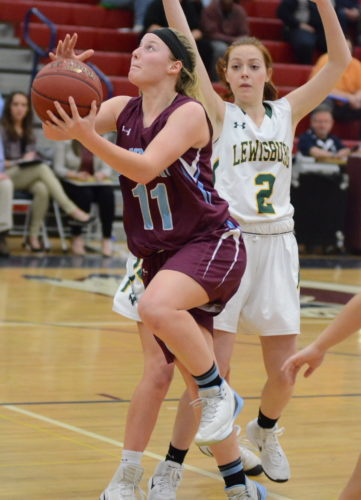 BRETT R. CROSSLEY/For The Sun-Gazette Loyalsock's Summer McNulty drives against a Lewisburg defender on Friday at Shikellamy during the HAC girls basketball championship.