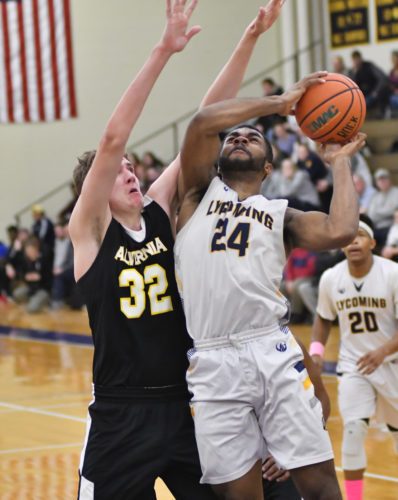 MARK NANCE/Sun-Gazette Lycoming's Chris Wallace, above, and teammate Alex Newbold are both averaging double-figures scoring as Wallace leads the Warriors this year.