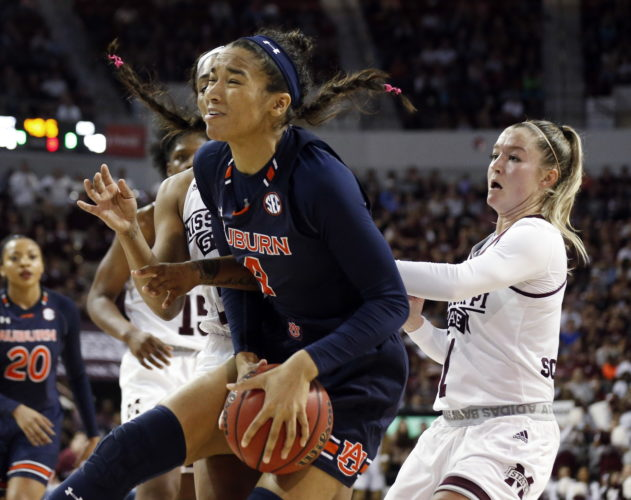 Auburn forward Abigayle Jackson (4) reacts after pulling a rebound away from Mississippi State guard Blair Schaefer, right, during the second half of an NCAA college basketball game in Starkville, Miss., Thursday, Feb. 22, 2018. Mississippi State won 82-61. (AP Photo/Rogelio V. Solis)