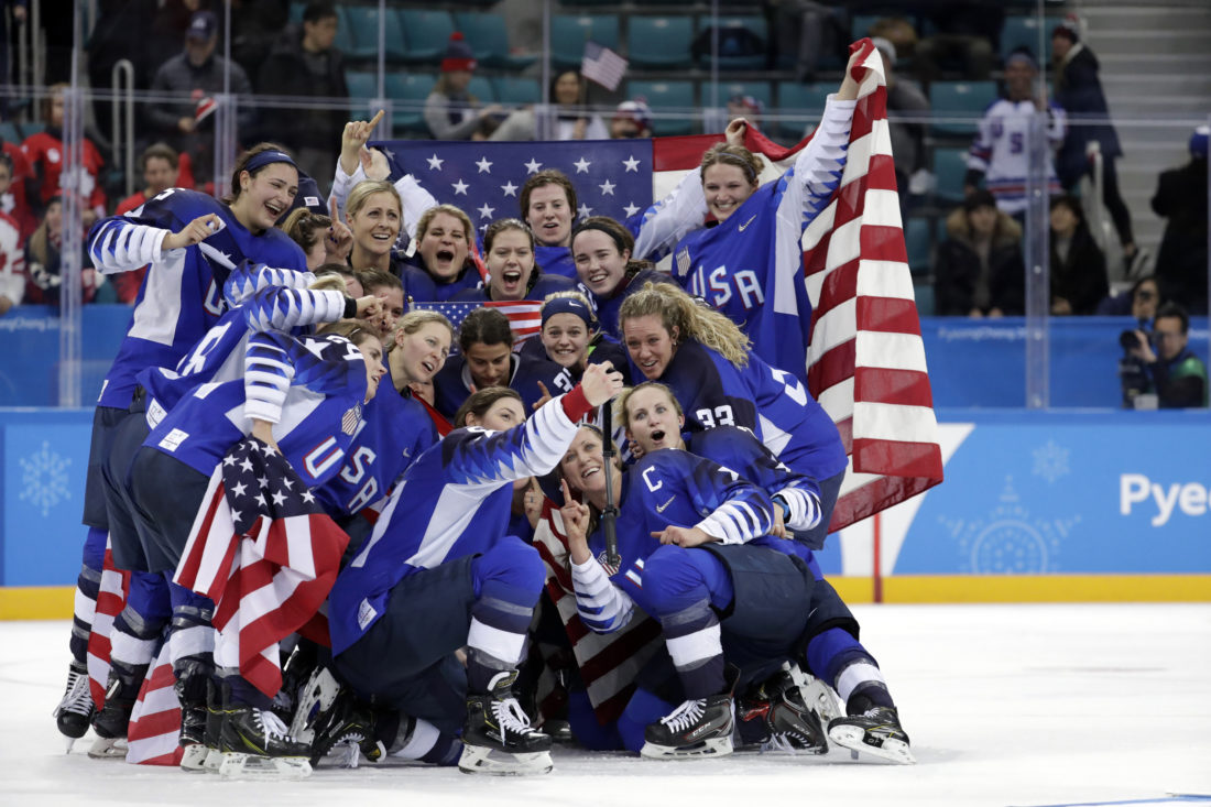 Megan Keller, whose grandparents live in Williamsport, and her fellow United States hockey team members celebrate with their gold medals after beating Canada in the women's gold medal hockey game at the 2018 Winter Olympics in Gangneung, South Korea, on Thursday. Keller is at the top left.