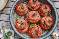 This Jan. 31, 2018 photo shows quinoa-stuffed tomatoes in Bethesda, Md. This dish is from a recipe by Melissa d'Arabian. (Melissa d'Arabian via AP)