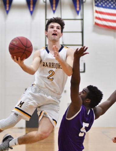 MARKNANCE/Sun-Gazette Montoursville's Owen Kiess (2) shoots over Shamokin's Jahleke West (5) in the fourth quarter at Montoursville High School on Friday.
