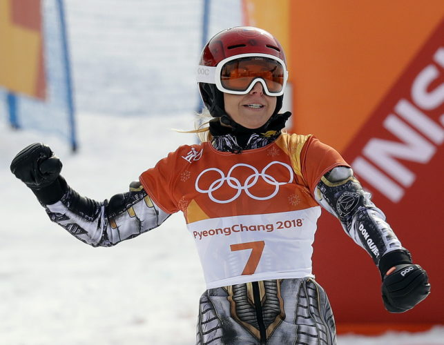 ASSOCIATED PRESS Gold medal winner Ester Ledecka, of the Czech Republic, celebrates after the women's parallel giant slalom final at Phoenix Snow Park at the 2018 Winter Olympics in Pyeongchang, South Korea, on Saturday.