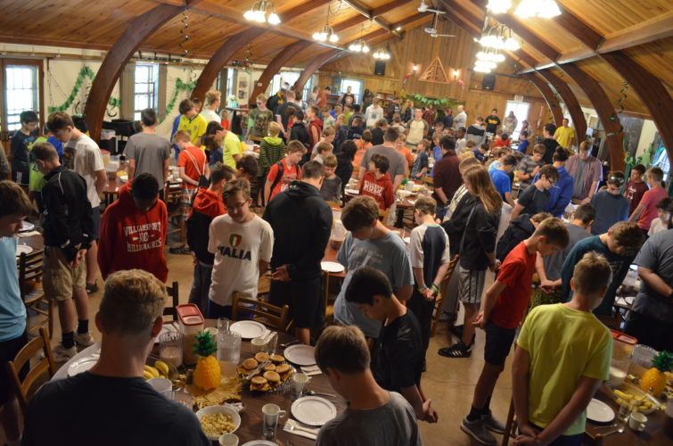 PHOTO PROVIDED Campers stand for prayer during a week of summer camp at Camp Susque in Trout Run.