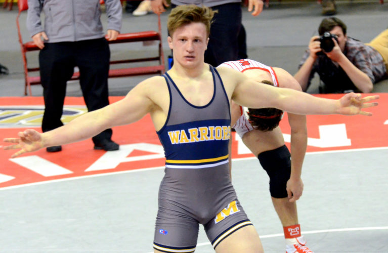FRANKDIMON/For The Sun-Gazette Montoursville's Gavin Hoffman celebrates his third state championship at the Giant Center in Hershey on Saturday. Hoffman became Lycoming County's first three-time state champion.