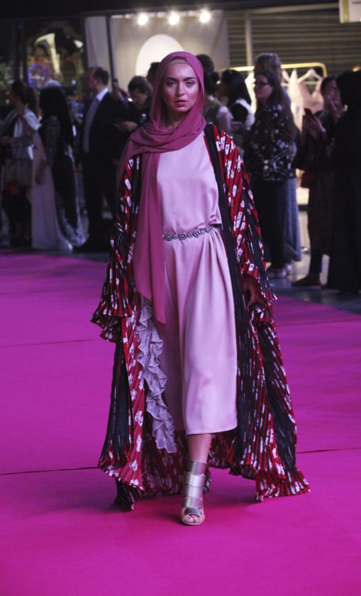 5eddcadf8d97 In this Wednesday, March 28, 2018 photograph, a model shows off a modest  fashion outfit in Dubai, United Arab Emirates. The Islamic Fashion and  Design ...