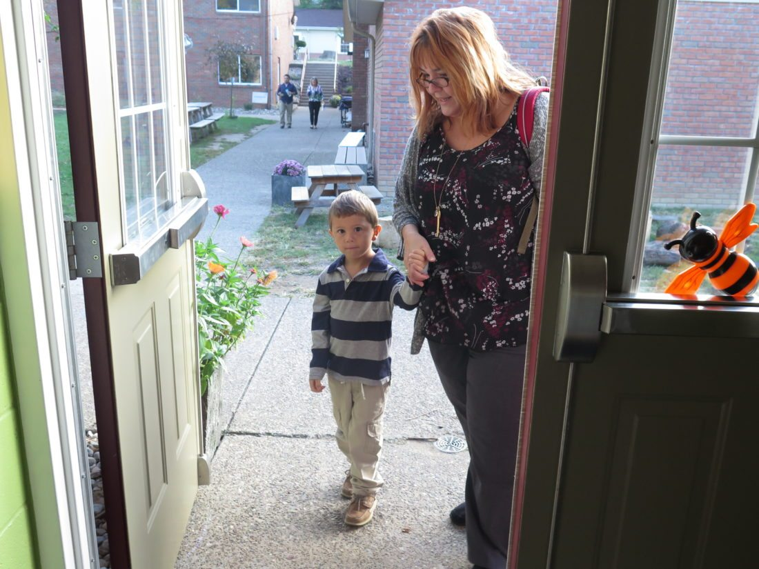 Photo by Betsy Bethel Dr. Christina Fisanick Greer walks her son, Tristan, to his kindergarten classroom at Wheeling Country Day School. She is teaching Tristan to eat healthy foods and right-sized portions, but doesn't restrict what he eats.