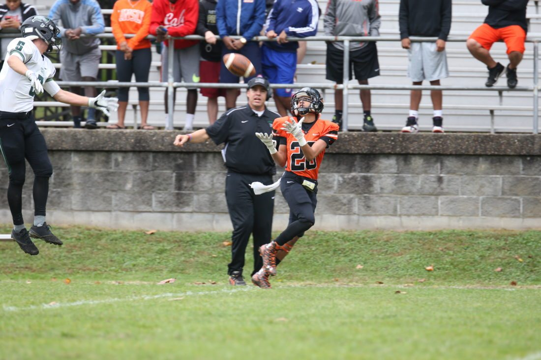 Photo by Alex Kozlowski Linsly receiver Tavion Minor (20)hauls in a touchdown pass from Wyatt Hirt in front of Western Reserve defender Michael Malen during their game Saturday at Lockhart Alumni Field in Wheeling.