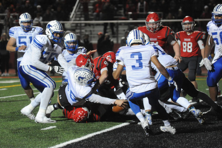 Photo by Tammy Shriver/Times West Virginian   Fairmont quarterback Jake Abbott extends the ball over the goal line in double-overtime to lift his team to victory last week, ending Bridgeport's three-year run as Class AA state champion.
