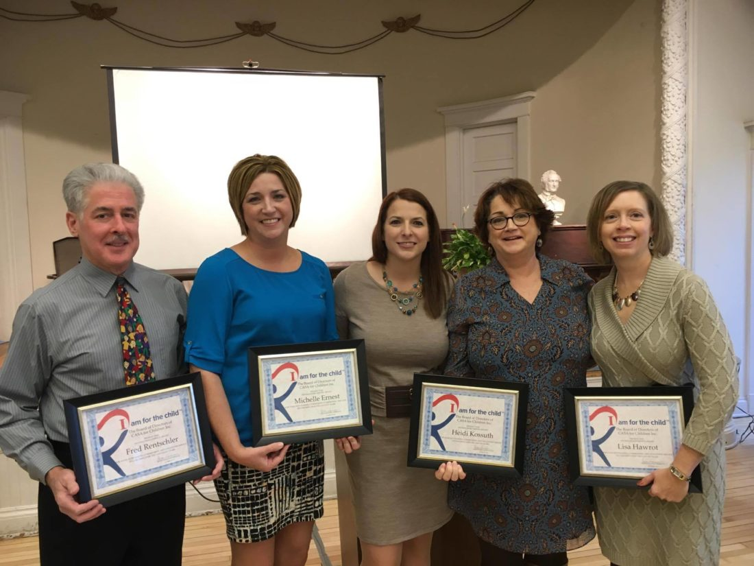Photo Provided Susan Harrison, center, executive director of CASA for Children Inc. presented awards on Nov. 30 to, from left, volunteer Fred Rentschler, former employee Shelly Ernest and outgoing board members Heidi Kossuth and Lisa Hawrot. Not pictured is outgoing board member Carrie White.