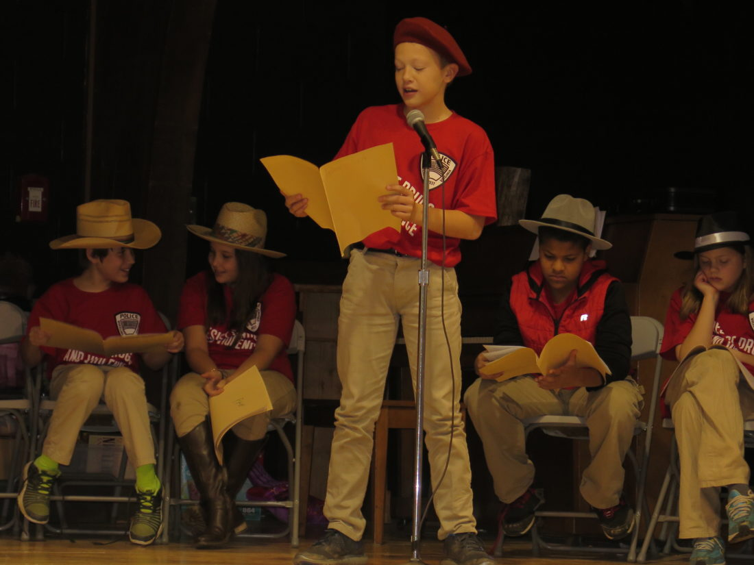 """Photo by Betsy Bethel Andrew Skadra portrays Ernest Moore """"E.M.""""Viquesney, sculptor of the American    Doughboy statue at Wheeling Park, during the radio show performed by Wheeling Country Day School fifth-graders Tuesday."""