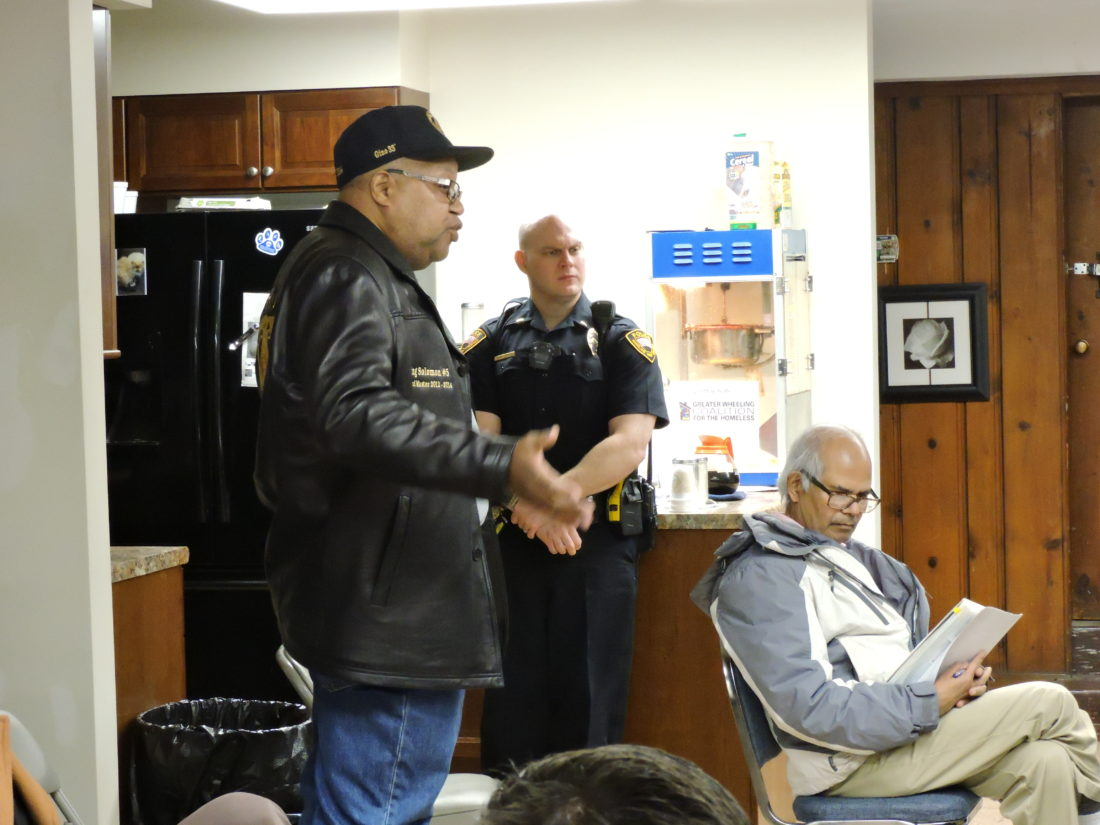 Photo by Janet Metzner Eugene Bernie, manager of the American Legion Post 89 in East Wheeling, speaks Monday evening attendees at the East Wheeling Crime Watch meeting.