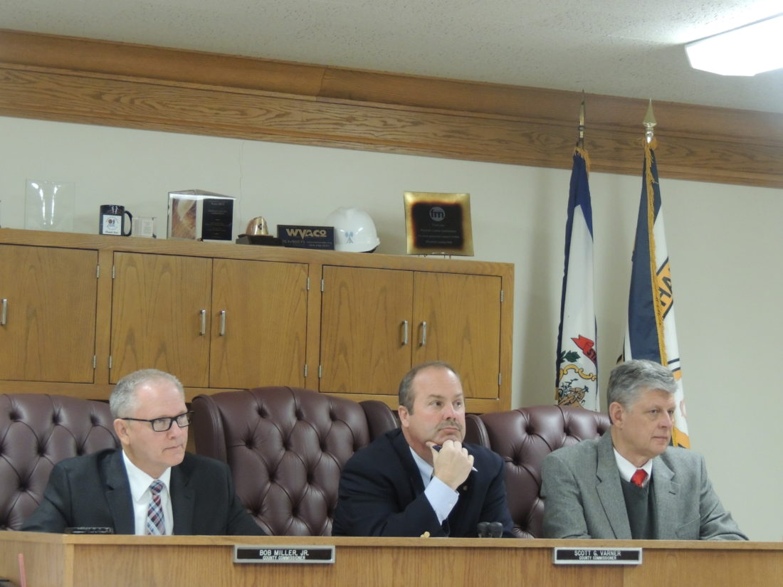 Photo by Drew Parker Marshall County Commissioners Bob Miller, from left, Scott Varner and John Gruzinskas hear concerns regarding youth baseball in McMechen.