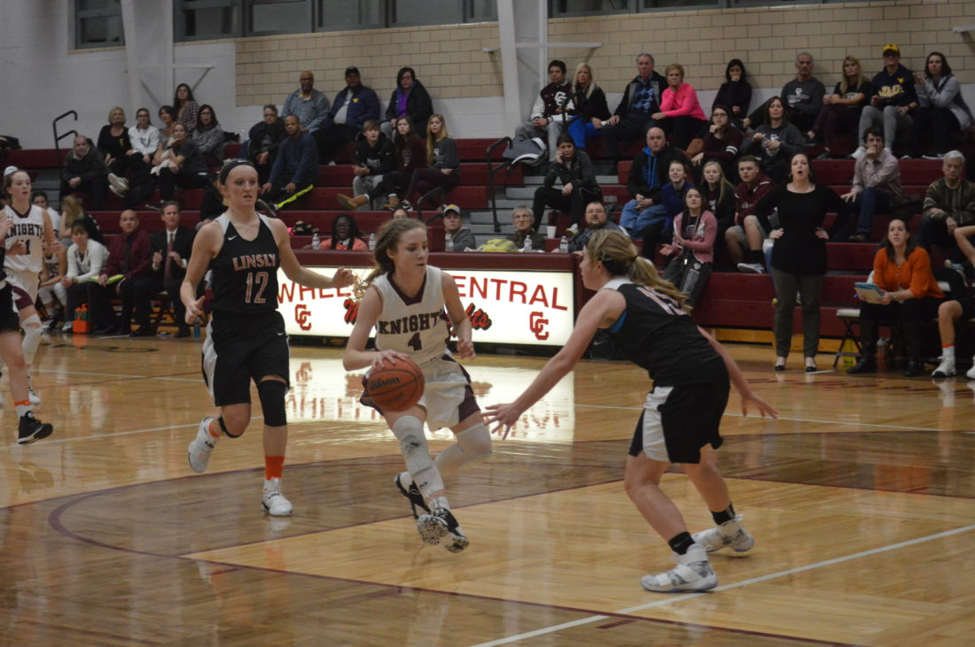 Wheeling Central's Eden Gainer (4)dribbles the ball down court  as teammate Emilee Ondrick (11) and Linlsy's  Vivian  Allison (12)  chase her down.   Photo by Kyle Lutz