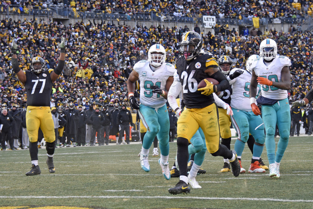 Pittsburgh Steelers running back Le'Veon Bell (26) scores on a short run during the second half of an AFC wild-card NFL football game against the Miami Dolphins in Pittsburgh, Sunday, Jan. 8, 2017. (AP Photo/Don Wright)