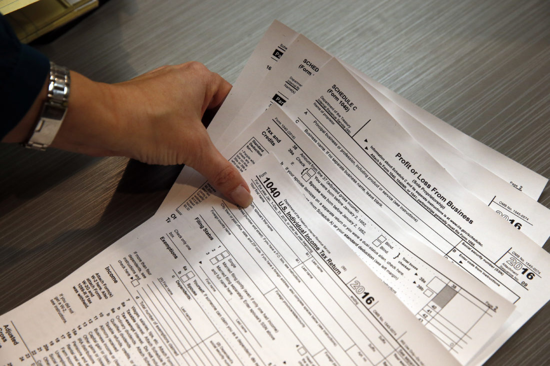 Some refunds delayed as irs battles against fraud intensifieds 14 2017 photo tax professional and tax preparation firm owner alicia utley reaches for hard copies of tax forms while working to stay caught up on a falaconquin