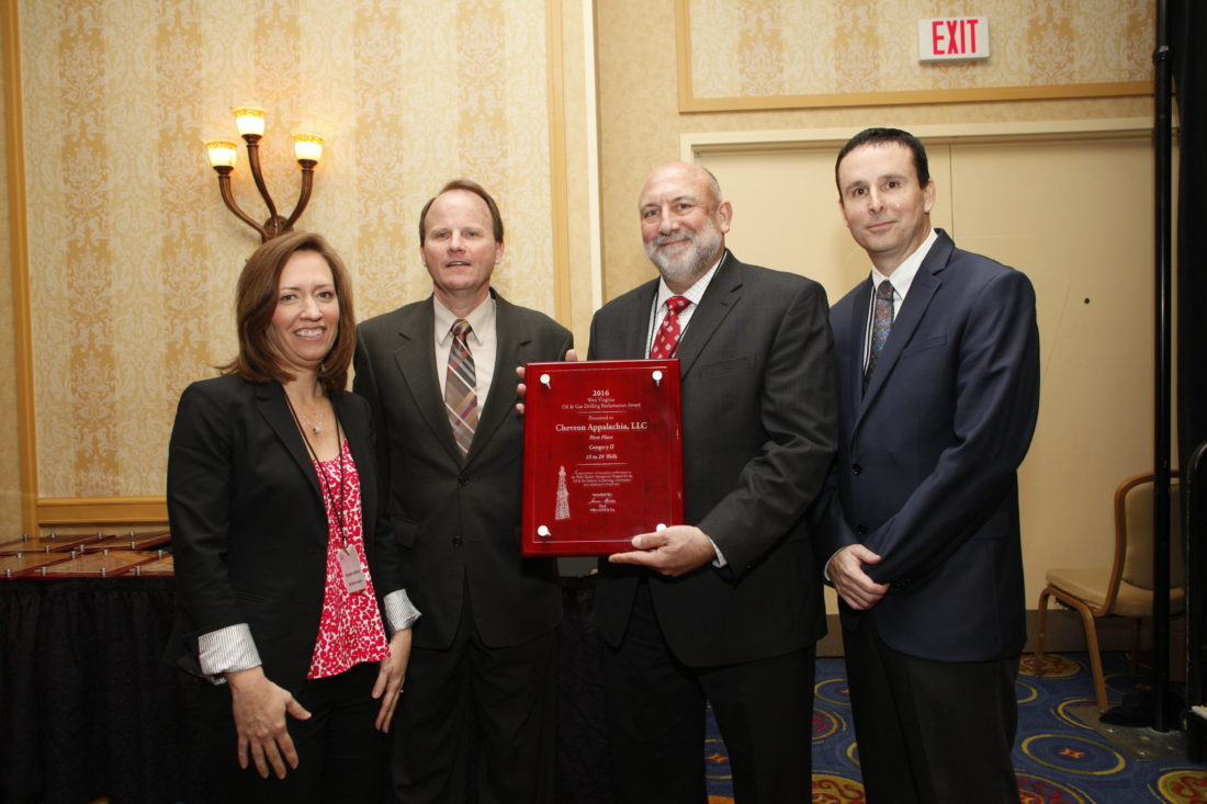 Photo Provided West Virginia Department of Environmental Protection officials acknowledge Chevron Appalachia with the Oil & Gas Reclamation Award, Wednesday in Charleston. From left are West Virginia Oil and Natural Gas Association President Maribeth Anderson, Office of Oil and Gas Chief James Martin, Chevron Regulatory Compliance and Permitting Manager Randall York and Independent Oil and Gas Association of West Virginia President Scott Freshwater.
