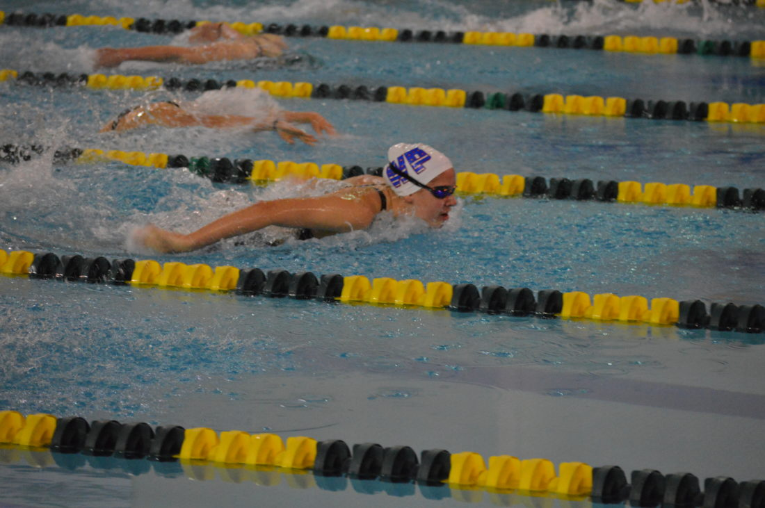Photo by John McCabe Wheeling Park sophomore Sarah Heilman leads the field as she finishes first in the qualifying round of the 100 butterfly at the West Virginia State Swim Meet Thursday in Morgantown.