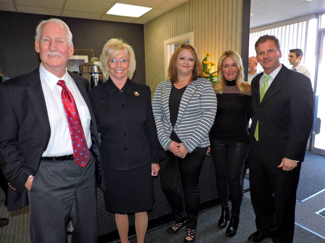 Photo by Shelley Hanson Paull Associates Real Estate Ohio staff celebrate the opening of their new office in St. Clairsville. From left are Lee Paull III and his wife, June; Ohio office manager and agent Sonya Olaka; and Jennifer Paull and her husband, Lee Paull IV, the broker for the new office.