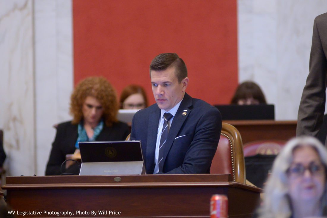 Photo by Will Price, W.Va. Legislature West Virginia Sen. Ryan Weld, R-Brooke, reviews information during a Senate floor session April 6.