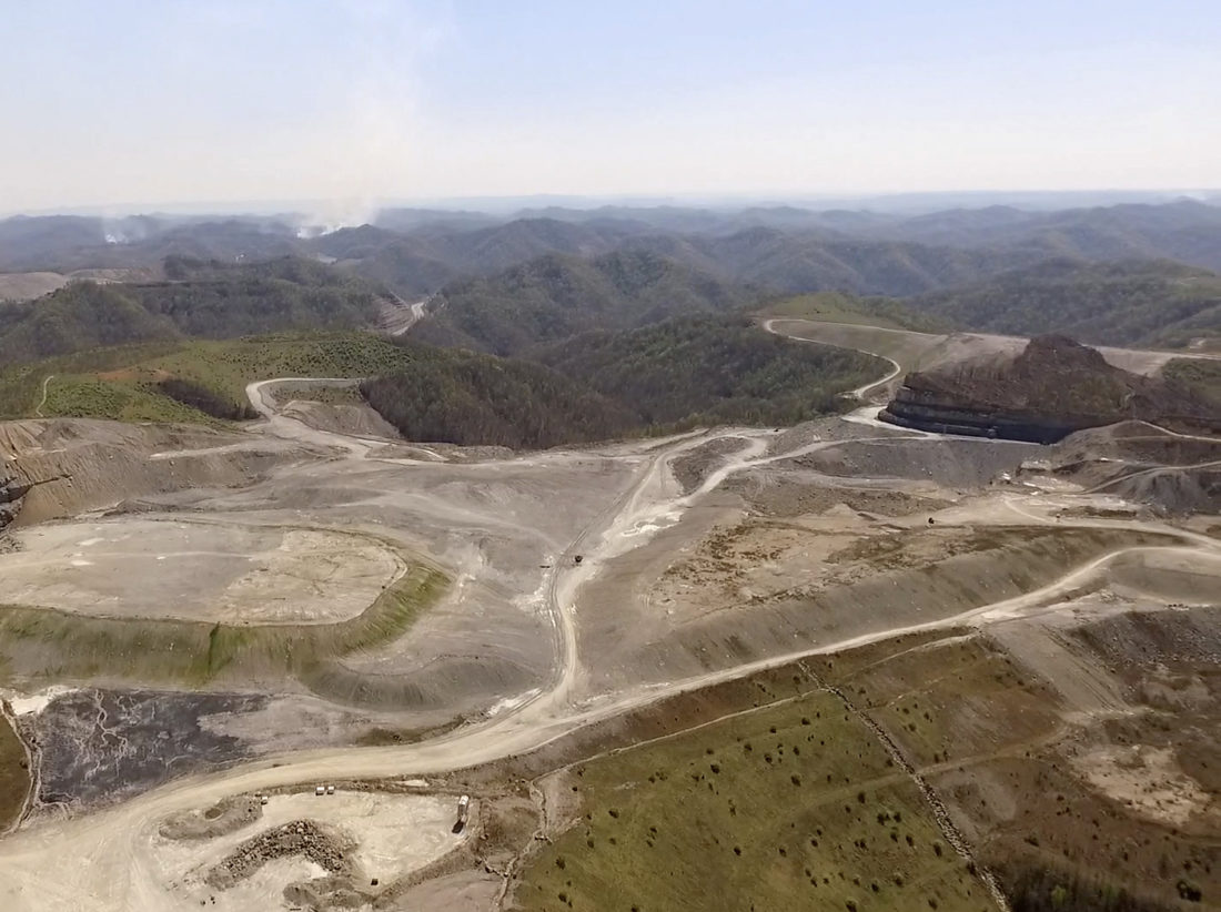 This undated image provided by the Berkeley Energy Group shows a mountaintop removal site near Pikeville, Ky. The Berkeley Energy Group, EDF Renewable Energy and former state Auditor Adam Edelen announced Tuesday, April 18, 2017, they are looking at two mountaintop removal sites to turn one into a solar farm. (Kenny Stanley/Berkeley Energy Group via AP)