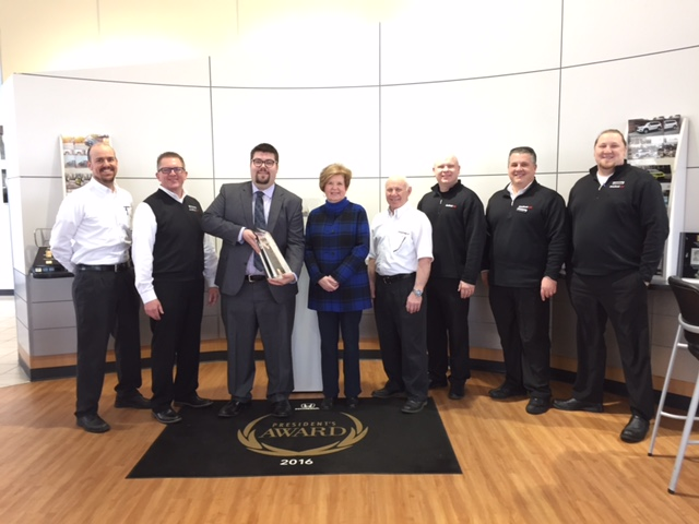 Photo by Rick Armstrong Gathering to celebrate Straub Honda being chosen to receive American Honda's 2016 President's Award for the second year in a row, from left, are Rick Maine, Kevin Cook, Josh Culbert with American Honda, Ginger Fato, Tom Fato, Bryan Fato, Peter Payne and Nick Eikey.