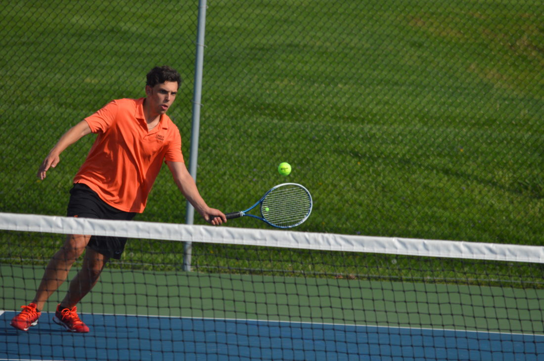 Photo by Cody Tomer. Linsly's Manuel Suita competes in his No. 2 singles match against Wheeling Central's David Agcaoili on Thursday at Mount DeChantal.